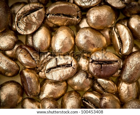 closeup of golden coffee beans. background. texture