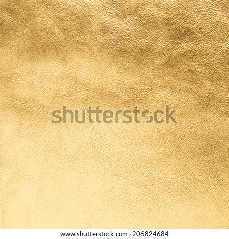 Closeup of golden color leather texture background. - stock photo