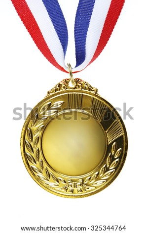 Closeup of golden medal on plain background - stock photo