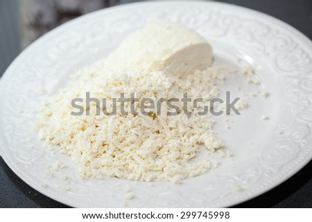 Closeup of grated paneer cheese with selective focus - stock photo