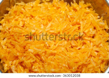 Closeup of grated pumpkin with selective focus - stock photo