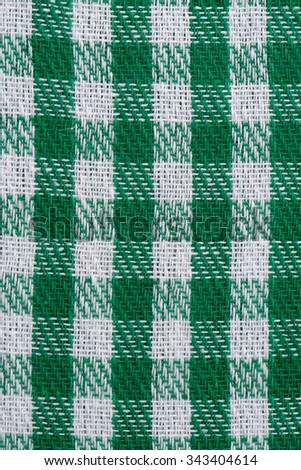 Closeup of green checked fabric background. - stock photo