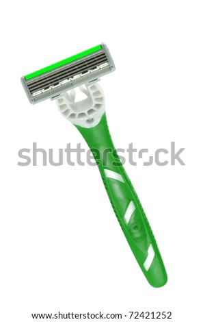 Closeup of green shaving blade on white surface - stock photo