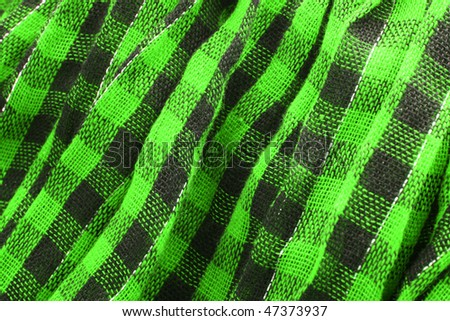 Closeup of green tartan fabric - stock photo
