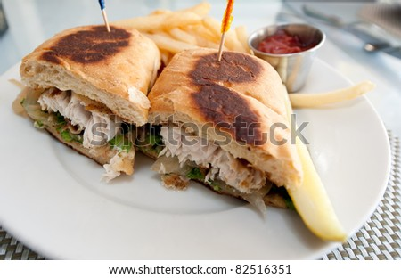 Closeup of grilled sandwich of fish, mahi mahi, also known as dolphin. - stock photo