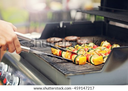 Closeup of grilled shashliks on grate
