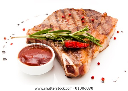 Closeup of grilled steak with peper corns and rosemary - stock photo