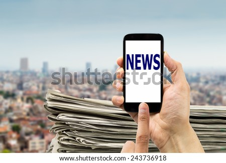 closeup of group of newspapers online in telephone on a city background  - stock photo
