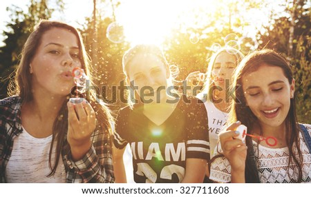Closeup of group of teenagers outside on a summer day - stock photo