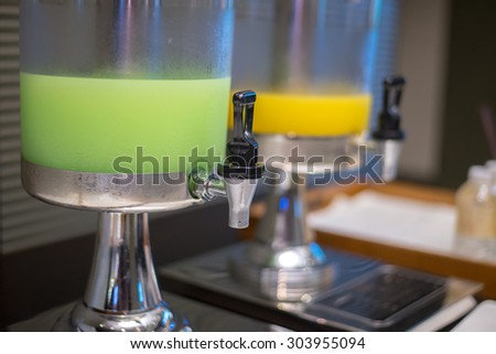 Closeup of Guava and Orange juice in water cooler for guess of seminar in the hotel - stock photo