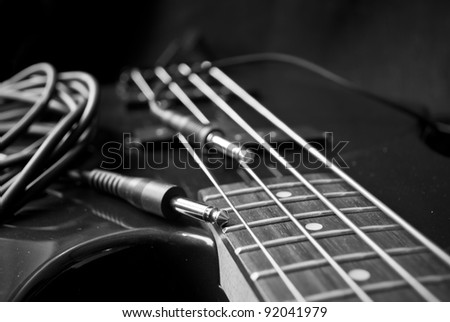 closeup of guitar strings and jacks, black and white - stock photo