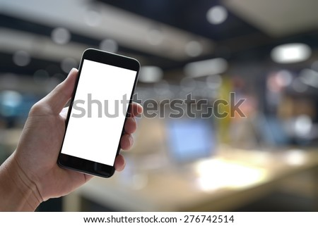 Closeup of Hand holding Blank Screen of Smart phone with blurred background as concept - stock photo