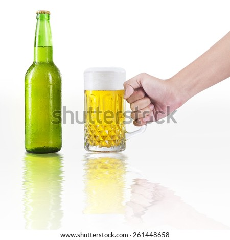 Closeup of hand take a glass of beer with bottle, isolated on white background - stock photo