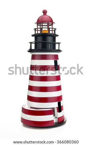 Closeup of handcrafted wooden birdhouse in shape of lighthouse on white background - stock photo