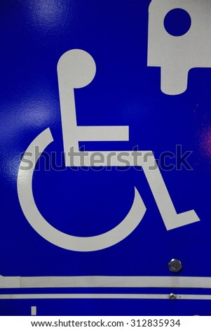 Closeup of handicapped parking place sign  - stock photo