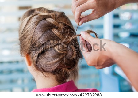 closeup of hands doing hair - stock photo