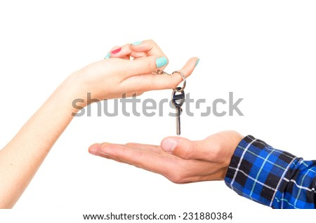 closeup of hands handing over key concept of buying deal sale realtor isolated on white - stock photo