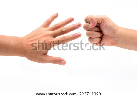 Closeup of hands making sign as rock paper and scissors