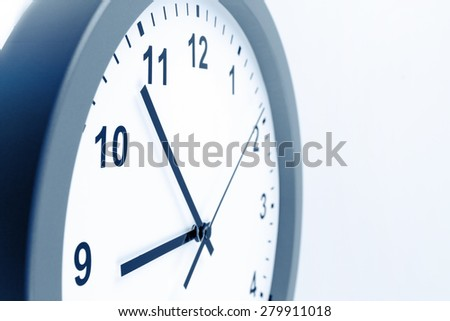 Closeup of hands on clock face - stock photo