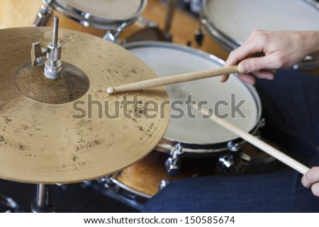 Closeup of hands playing drum set - stock photo