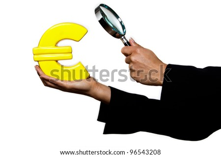 Closeup of hands surveying Euro in studio isolated on white background - stock photo