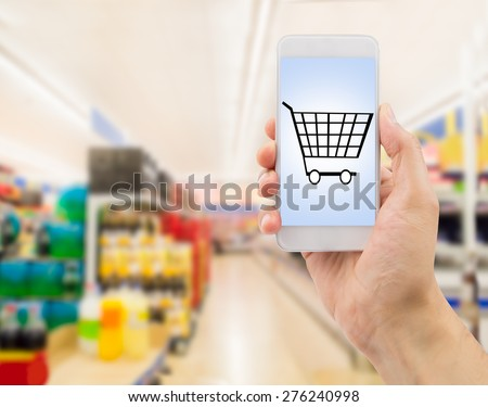 Closeup of hands using smartphone in supermarket .screen content is designed by us and not copyrighted by others and created with wacom tablet and ps - stock photo