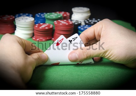 Closeup of hands with double ace - stock photo