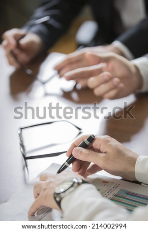 closeup of hands with financial charts at business meeting in the office