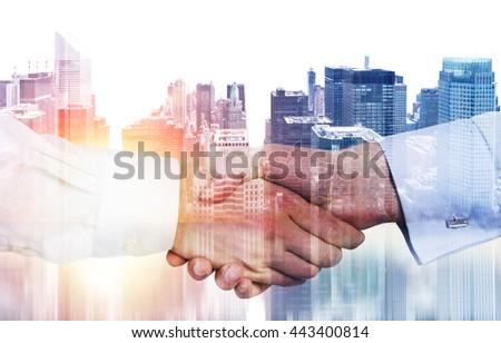 Closeup of handshake on New York city background with sunlight. Double exposure - stock photo