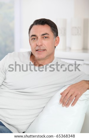 Closeup of handsome man relaxing in sofa