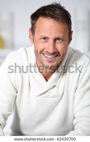 Closeup of handsome man with white sweater