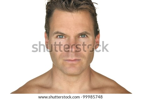 Closeup of handsome shirtless man with hazel eyes on white background