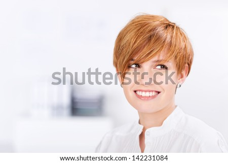 closeup of happy beautiful businesswoman with red hair in office