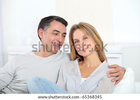Closeup of happy couple at home - stock photo