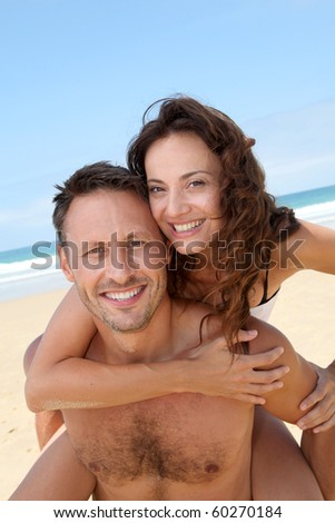 Closeup of happy couple at the beach - stock photo