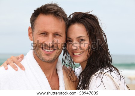 Closeup of happy couple in spa treatment - stock photo