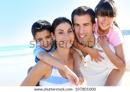 Closeup of happy family at the beach - stock photo