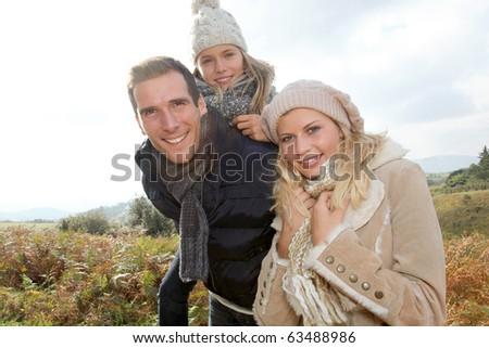 Closeup of happy family in fall season - stock photo
