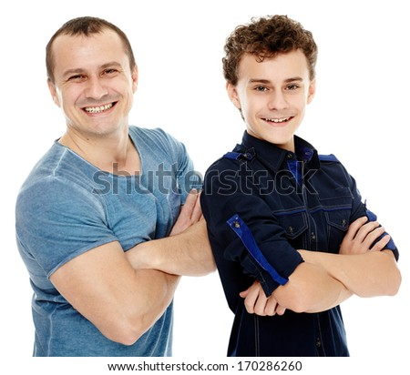 Closeup of happy father and son with arms folded, isolated on white background - stock photo