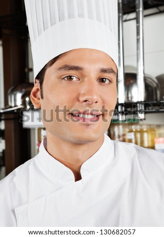 Closeup of happy male chef in commercial kitchen