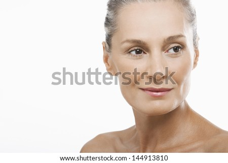 Closeup of happy middle aged woman looking away isolated on white background - stock photo
