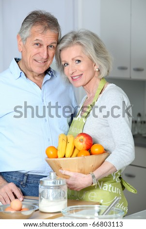 Closeup of happy senior couple in kitchen