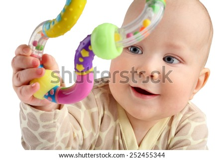 Closeup of happy seven months baby boy grabbing a toy isolated. - stock photo