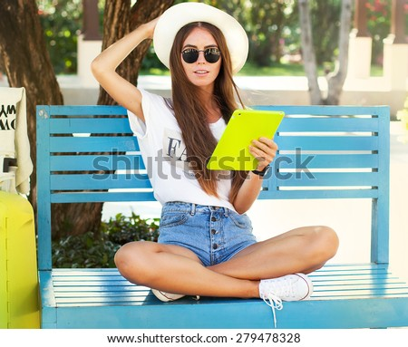 http://thumb1.shutterstock.com/display_pic_with_logo/3026723/279478328/stock-photo-closeup-of-happy-woman-in-glasses-using-tablet-pc-in-the-park-young-woman-wearing-stylish-hipster-279478328.jpg