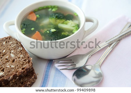 Closeup of healthy vegetable soup with wholemeal bread
