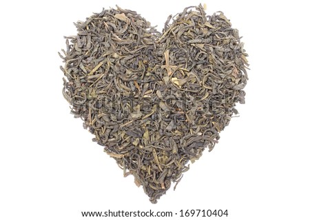 Closeup of heart shaped green tea, valentine heart of green tea. Isolated on white background - stock photo