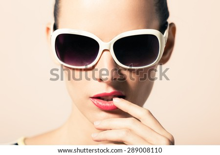 Closeup of high fashion female model wearing shades.