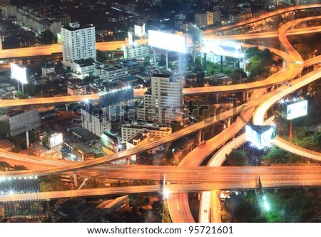 Closeup of highest Aerial view of Bangkok Highway at Dusk in Thailand - stock photo