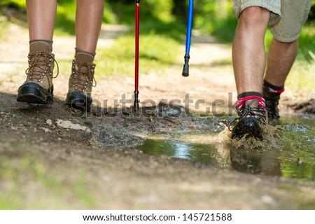 Closeup of hiker legs wearing trekking boots - stock photo