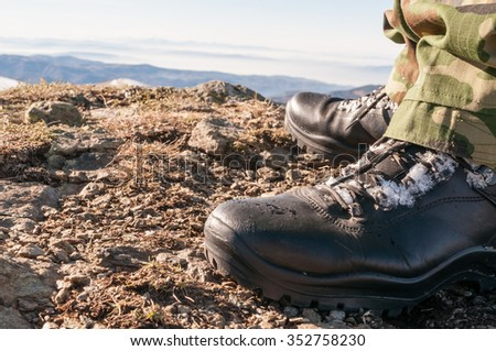 Closeup of hiking boots on a gravel.